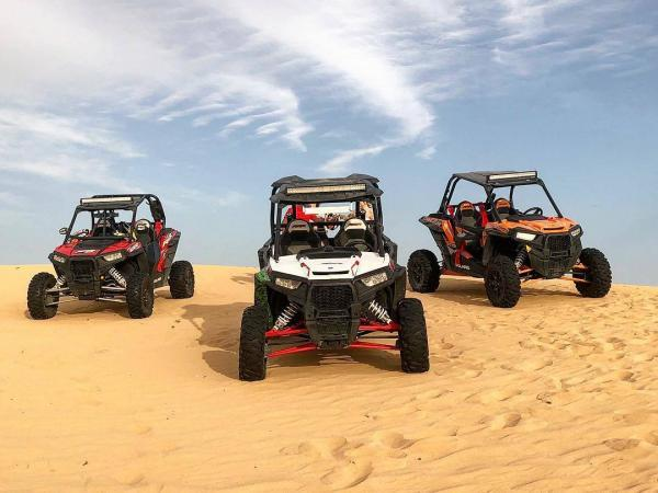 dune buggies in the desert of Dubai